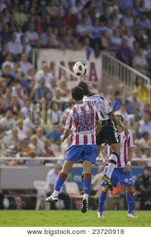 VALENCIA, SPAIN - SEPTEMBER 22 - FootBall Match of Spanish Soccer League between Valencia C.F. vs AT. Madrid - Luis Casanova Stadium - Diego Costa, ricardo Costa - Spain on September 22, 2010