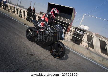 VALENCIA, SPAIN - FEBRUARY 11: Participant in the Moto2 and 125cc Test - unrecognizable moto2 rider - on February 11, 2011 in Cheste, Valencia, Spain