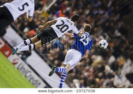 VALENCIA, SPAIN - FEBRUARY 15 - #20 Ricardo Costa and Huntelaar in the UEFA Champions League between Valencia C.F. vs Schalke 04 - Mestalla Luis Casanova Stadium - Spain on February 15, 2011