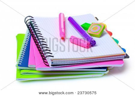 notebooks, paper clips, ruler, and markers isolated on white