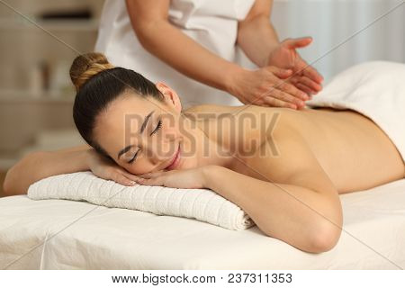 poster of Happy Woman Relaxing Receiving A Massage In A Spa Salon