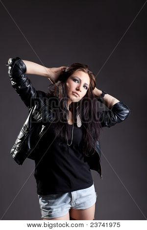 Sexy woman in grunge style - leather jacket