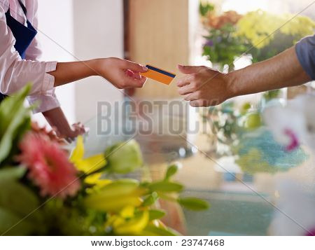 Client With Credit Card Shopping In Flowers Shop