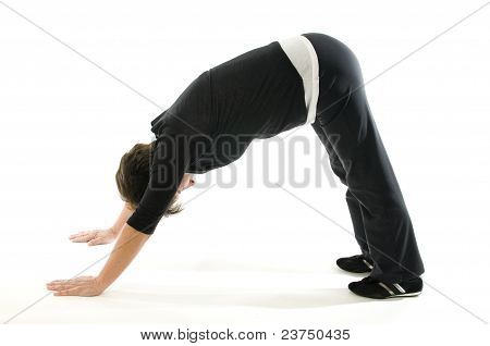 Middle Age Senior Woman Downward Facing Dog Yoga Position