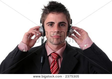 Young Businessman Listen Music On White
