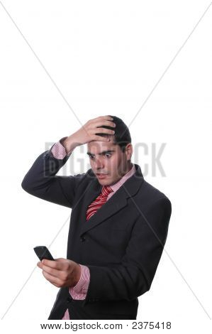 Young Businessman With And On Head And Looking To Cell Phone