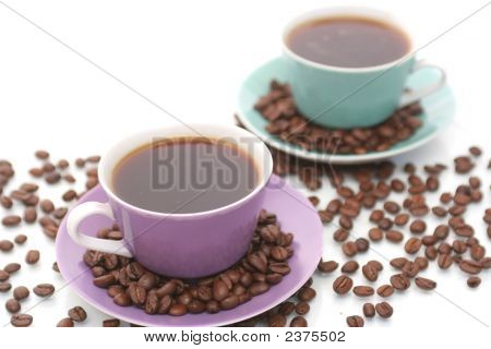 Two Beautiful Cups From Coffee On A White Background