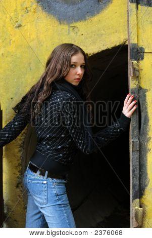 Young Model With Dark Hairs Near Graffiti Wall. Fall. Autumn
