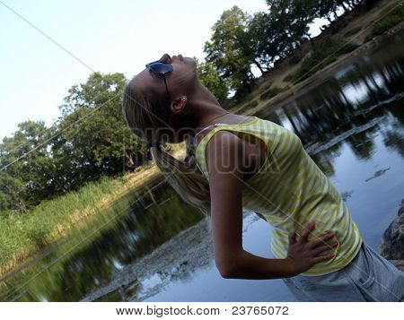 The young girl on lake