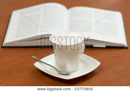 Coffe and a opened book. Learning abstract