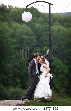 Bride and groom under lantern