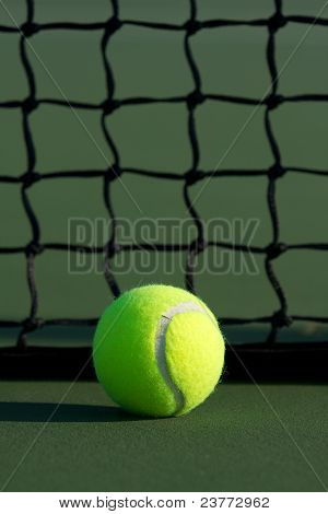 Tennis Ball Against The Net