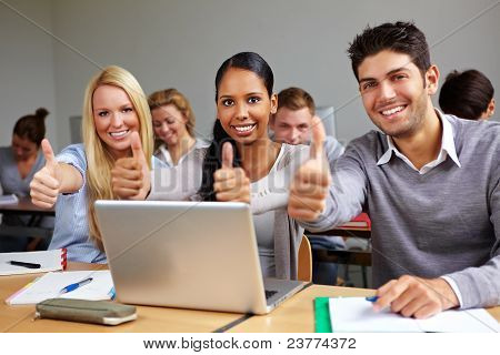 Students In Class Holding Thumbs Up