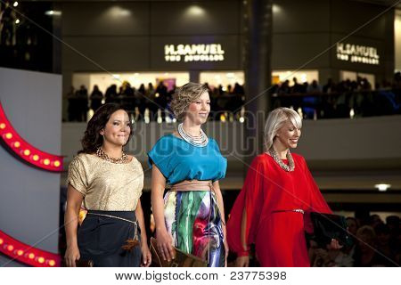 SOUTHAMPTON, UK - SEPT 22: On the catwalk, three unidentified local nurses who have been the subject of a Gok Wan makeover arrive at the West Quay shopping Center during filming of Gok's Clothes Roadshow on Sept. 22, 2011 in Southhampton, UK.