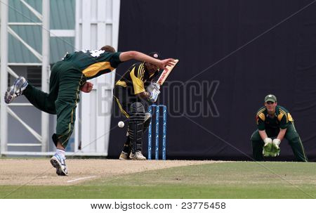 PUCHONG, MALAYSIA - SEPT 24: Adam Martel, Guernsey bowls Rakesh Madhavan, Malaysia at the Pepsi ICC World Cricket League Div 6 finals at the Kinrara Oval on September 24, 2011 in Puchong, Malaysia.