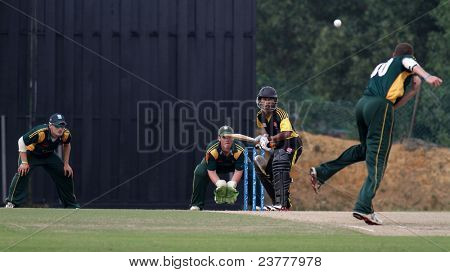 PUCHONG, MALAYSIA - SEPT 24: Jeremy Frith, Guernsey bowls Faris Lee, Malaysia at the Pepsi ICC World Cricket League Div 6 finals at the Kinrara Oval on September 24, 2011 in Puchong, Malaysia.