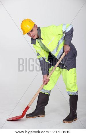 Labourer shovelling