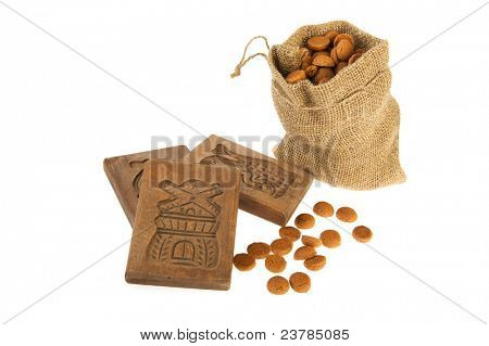 Traditional Dutch Sinterklaas attributes as Speculaas boards and pepernoten