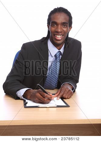 African American Businessman Signing Document