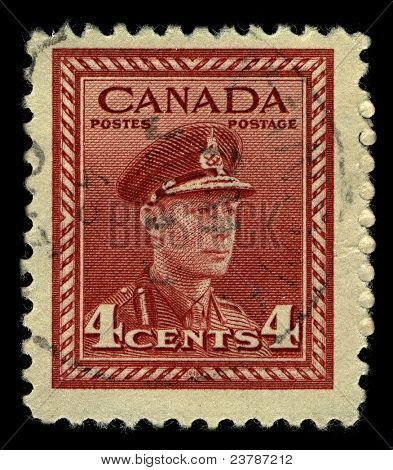 CANADA-CIRCA 1942:A stamp printed in CANADA shows image of George VI (Albert Frederick Arthur George) was King of the United Kingdom and the Dominions of the British Commonwealth, circa 1942.