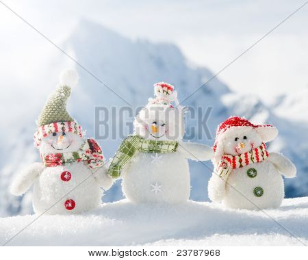 Winter - Happy snowman friends  in mountains (copy space)