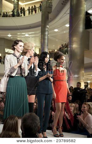SOUTHAMPTON, UK - SEPT 22: Professional models on the catwalk in West Quay shopping centre, Southampton, during filming of Gok's Clothes Roadshow. 22 September 2011, Southampton