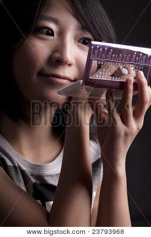 Asian Girl Applying Makeup