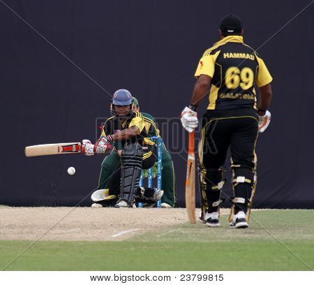 PUCHONG, MALAYSIA - SEPT 24: Malaysia's batsman Ahmad Faiz swings at the ball in this Pepsi ICC World Cricket League Div 6 finals vs Guernsey at the Kinrara Oval on Sept 24, 2011 in Puchong, Malaysia.