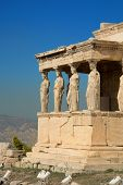 Caryatids on the Acropolis of Athens by a nice summer day poster