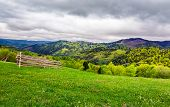Lovely Rural Scenery Of Carpathians. Beautiful Landscape With Grassy Rural Fields On Hills In Spring poster