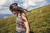 Happy Traveler Hipster Girl Walking In Sunny Mountains. Summer Vacation. Space For Text. Happy Atmos poster