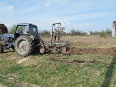 Tractor Plows The Land On The Land poster