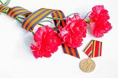 9 May Victory Day Background - Jubilee Medal Of Great Patriotic War With Red Carnations And St Georg poster