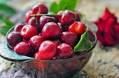 Cherries In Glass Bowl. Red Cherry And Leaf In Bowl And Napkin On Wooden Background With Sunlight. F poster
