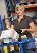 stock photo of warehouse  - worker scans pallets and boxes in the warehouse - JPG