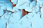 Texture Background Of Blue Peeling Paint On The Wooden Texture Surface. Closeup Of Blue Peeling Pain poster