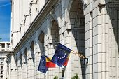 European Union And Romania Flags On The Wall Of The Building Of Ministry Of Regional Development And poster