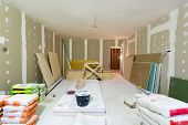 Materials For Construction Putty Packs, Sheets Of Plasterboard Or Drywall In Apartment Is Under Cons poster
