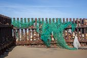 Discarded Nylon Plastic Fishing Net. Evironmental Sea Pollution Threat To Wildlife Washed Up On The  poster