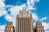 Ministry Of Foreign Affairs Of Russia Style Of Stalinist Architecture Against A Blue Sky With White  poster