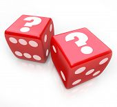Question marks on two red dice to symbolize an uncertain fate or future and the risks you take by un