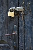 Brass Padlock Safety At Closed Old Door poster