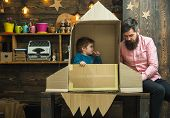 Boy Play With Dad, Father, Little Cosmonaut Sit In Rocket Made Out Of Cardboard Box. Rocket Launch C poster