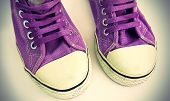 Old Lilac Sneakers On White Background With Vignetting Effect poster