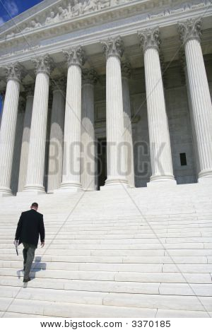 Man Walking Up To Supreme Court
