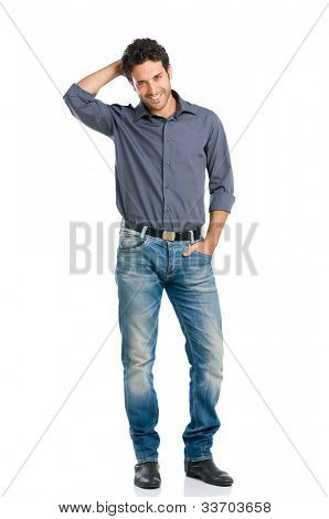 Stylish happy young man looking at camera with embarrassment isolated on white background