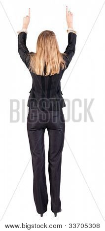 Back view of young blonde business woman pointing at wall . beautiful girl in dark suit. Rear view people collection. backside view of person.  Isolated over white background.