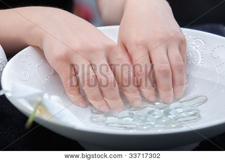 Woman's hands humidification in water