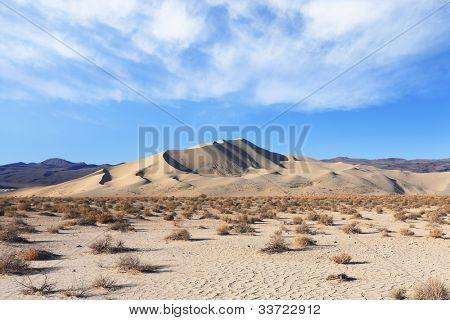 Cold sands of the famous Eureka - a giant sand dune in California. Early morning in the desert
