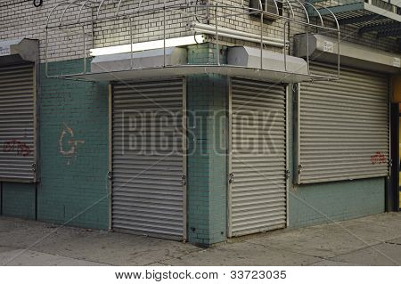 abandoned storefront with gate down